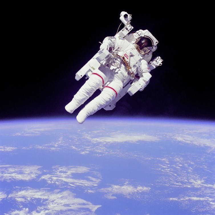 An astronaut floating alone in space