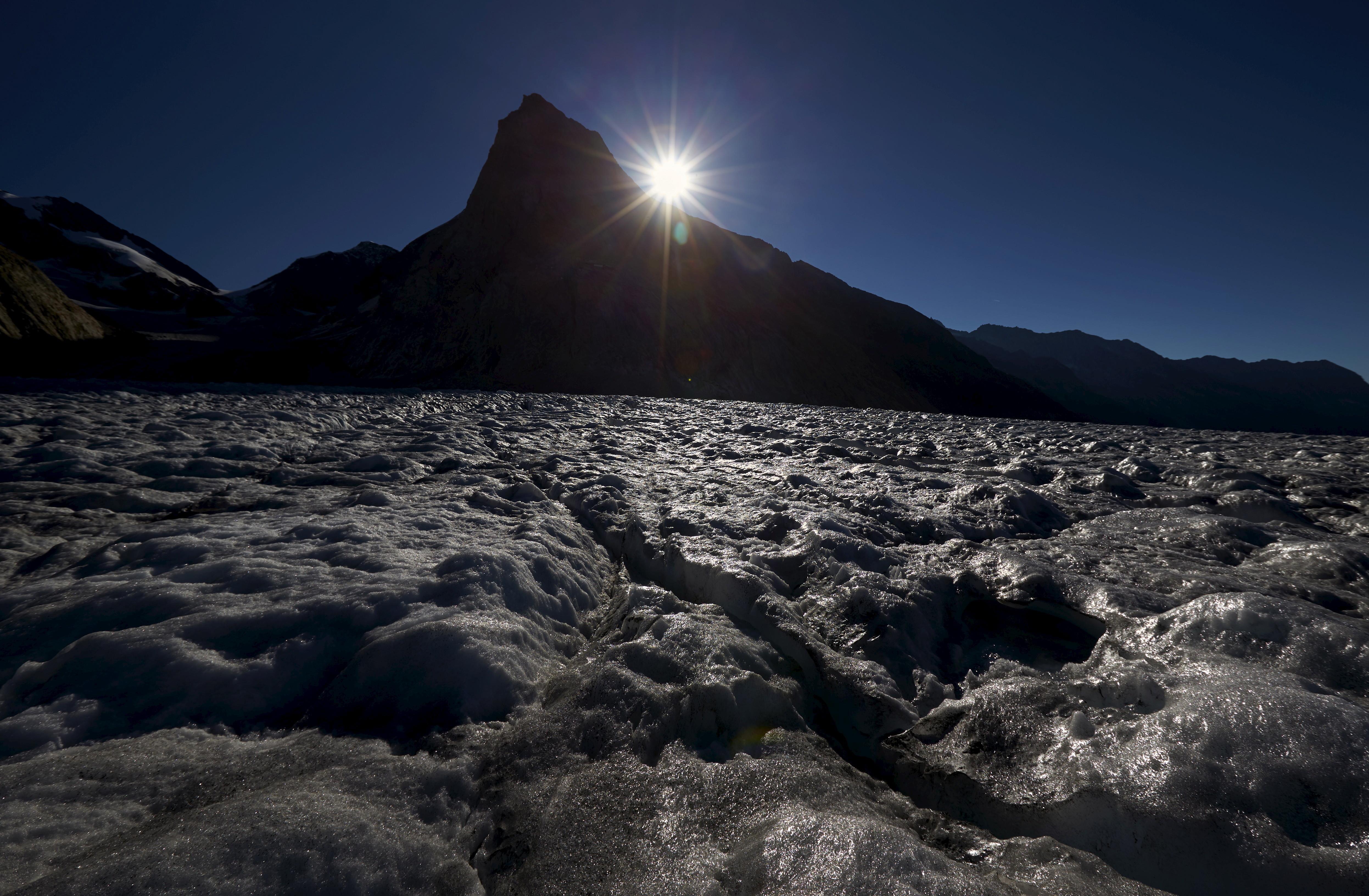 The sun rises behind the Konkordia Hut on the Aletsch Glacier, Switzerland, August 29.
