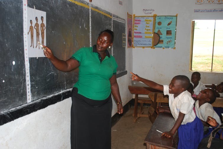 Irise educator teaches local girls in Uganda.
