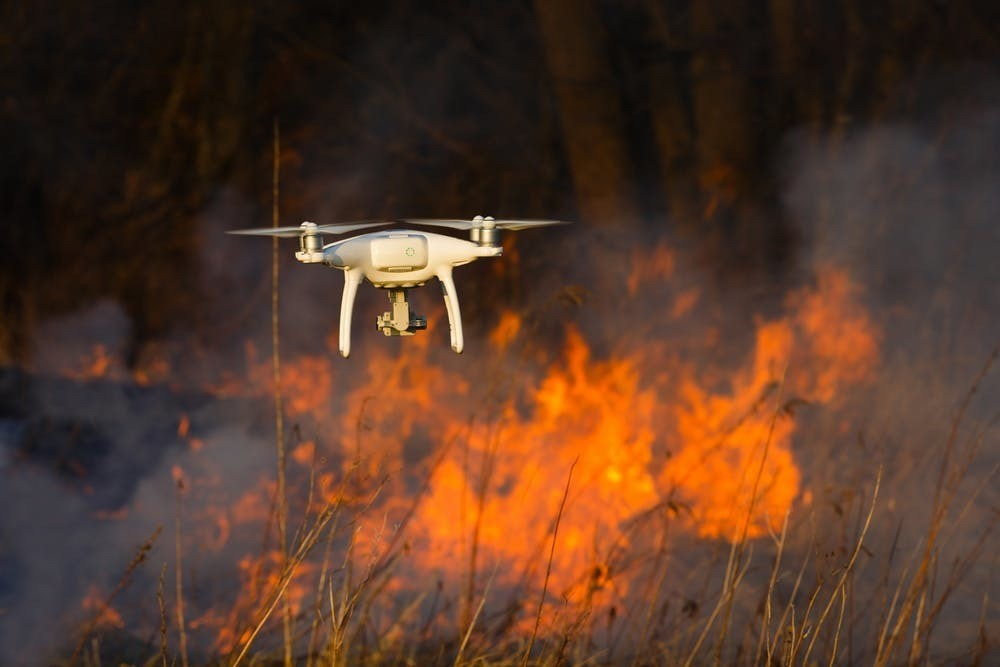 Drones can help map forest fires by surveying areas that are too difficult or dangerous to access.