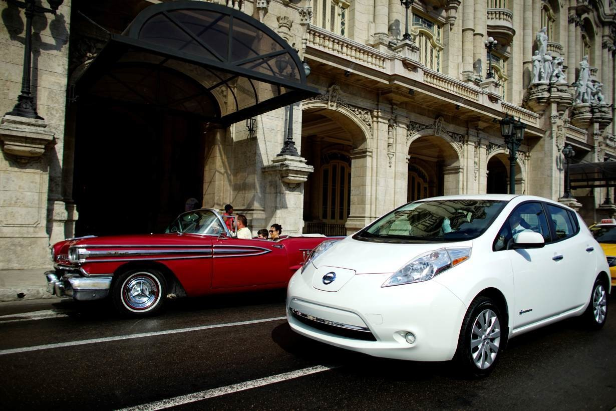 An electric car (R) recently acquired by Guyana Embassy is seen beside a vintage car during a ride for journalists in Havana, Cuba,