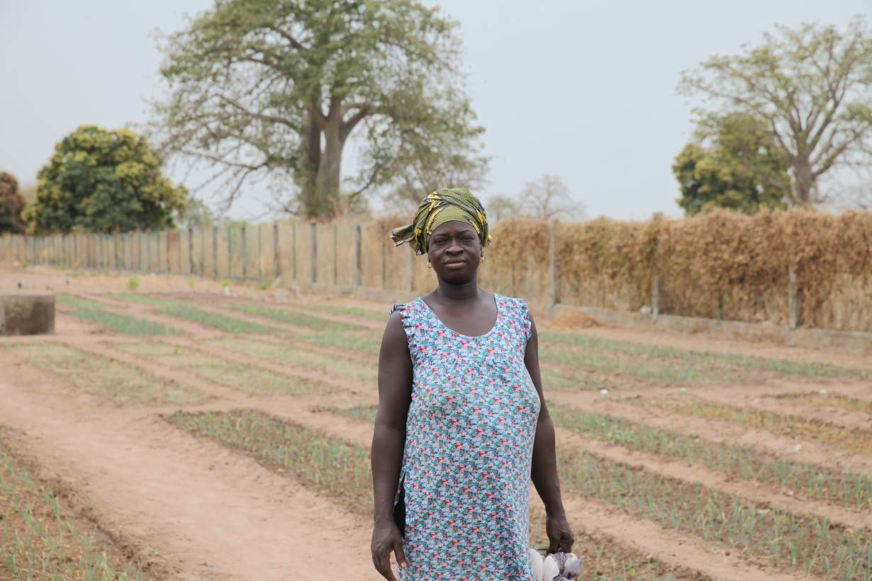 Farmer Jankey Drammeh poses for a portrait in the communal vegetable garden in the village of Jali, Gambia. January 23, 2020.