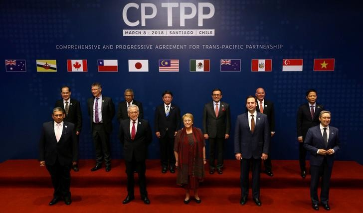 Representatives of members of Trans-Pacific Partnership (TPP) trade deal: Brunei's Acting Minister for Foreign Affairs Erywan Dato Pehin, Chile's Foreign Minister Heraldo Munoz, Chile's President Michelle Bachelet, Australia's Trade Minister Steven Ciobo and Canada's International Trade Minister Francois-Phillippe Champagne, Singapur's Minister for Trade and Industry Lim Hng Kiang, New Zealand's Minister for Trade and Export Growth David Parker, Malaysia's Minister for Trade and Industry Datuk J. Jayasiri, Japan's Minister of Economic Revitalization Toshimitsu Motegi, Mexico's Secretary of Economy  Ildefonso Guajardo Villarreal, Peru's Minister of Foreign Trade and Tourism Eduardo Ferreyros Kuppers and Vietnam's Industry and Trade Minister Tran Tuan Anh, pose for an official picture before the signing agreement ceremony in Santiago, Chile March 8, 2018. REUTERS/Ivan Alvarado