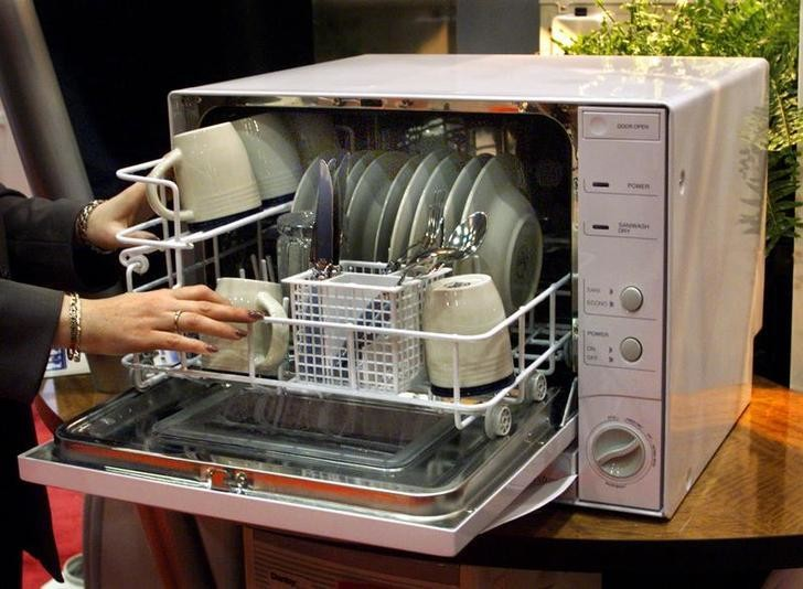 Danby Products Limited displays a countertop dishwasher at the International Housewares Show in Chicago. The dishwasher, which is about the size of a microwave oven, retails for $199. The show goes from January 16-19 at Chicago's McCormick Place.