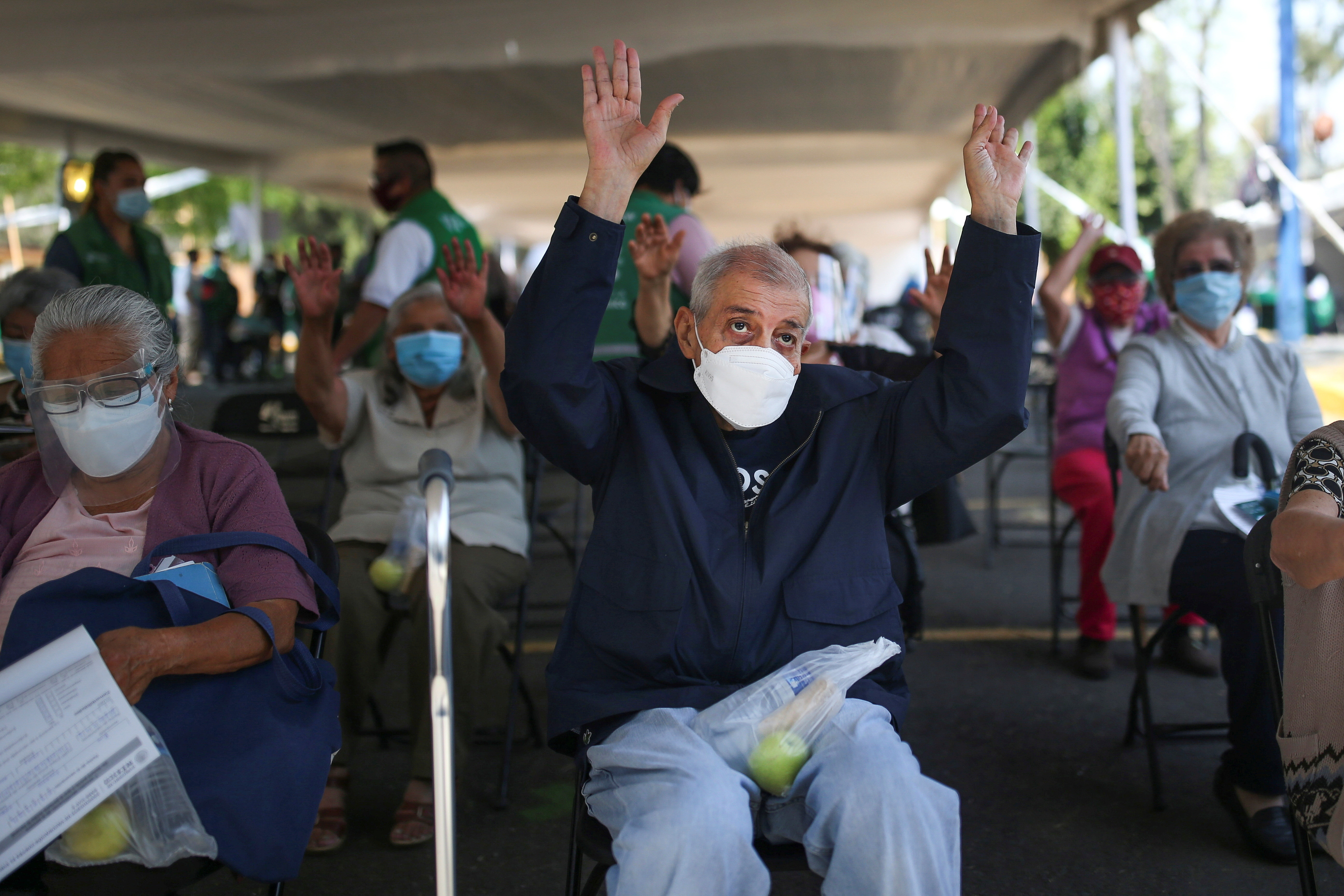 An elderly resident exercises after receiving the Sputnik V coronavirus disease (COVID-19) vaccine in Xochimilco on the outskirts of Mexico City, Mexico March 3, 2021. REUTERS/Edgard Garrido - RC2Y3M9A9CL6