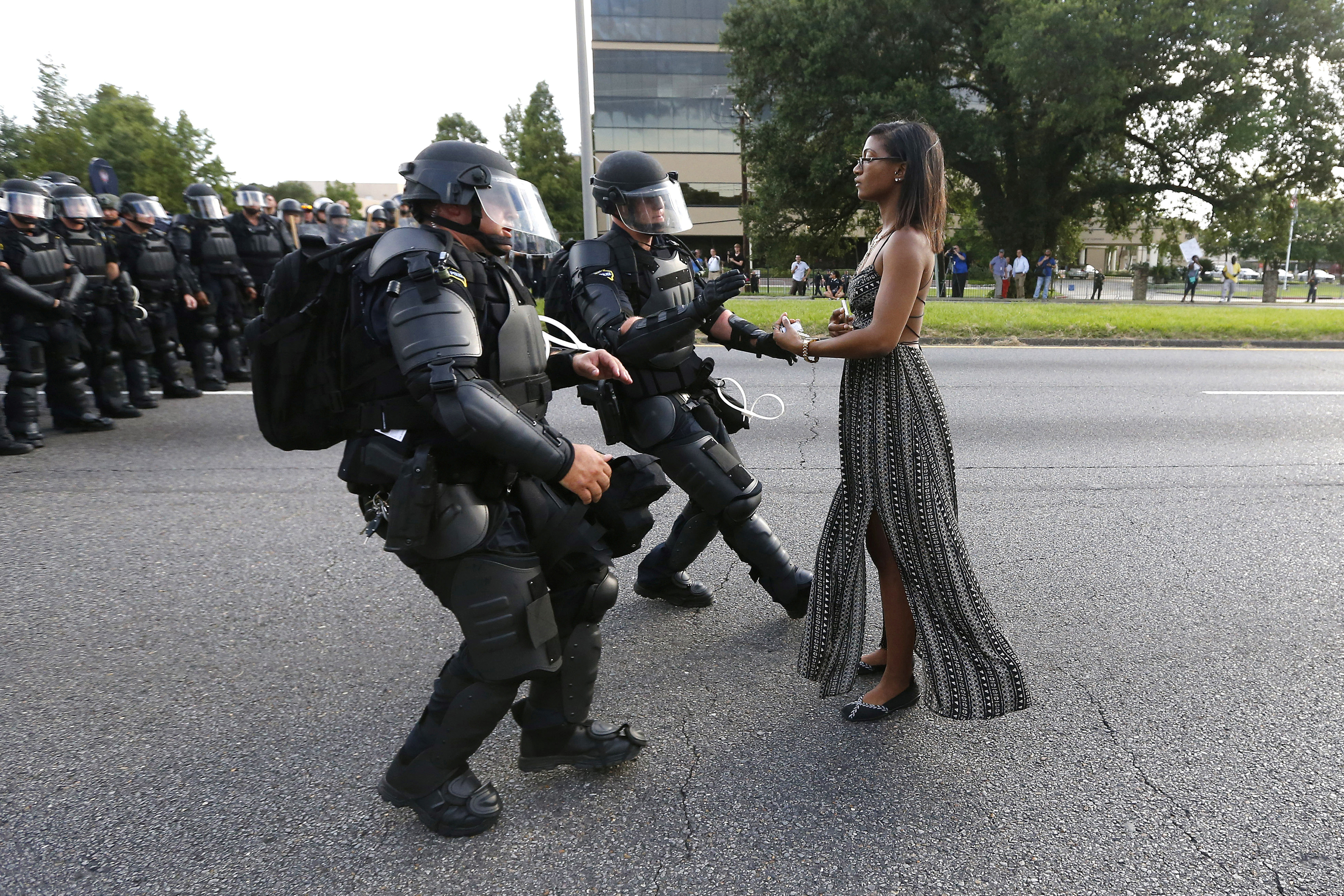 Lone activist Leshia Evans stands her ground while offering her hands for arrest as she is charged by riot police during a protest against police brutality outside the Baton Rouge Police Department in Louisiana, U.S.A., July 9 2016. Picture taken  9 July 2016.
