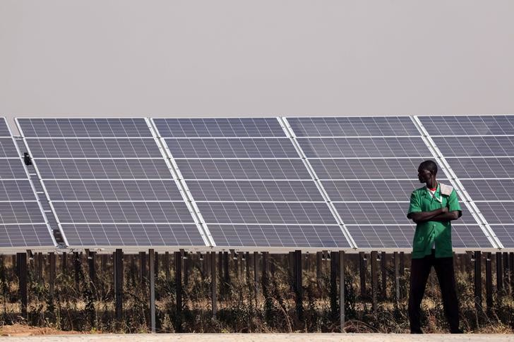 Solar panels are seen during the inauguration ceremony of the solar energy power plant in Zaktubi, near Ouagadougou, Burkina Faso, November 29, 2017.   REUTERS/Ludovic Marin/Pool