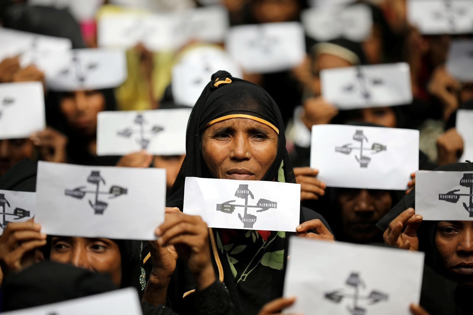 Rohingya refugee women hold placards as they take part in a protest at the Kutupalong refugee camp to mark the one-year anniversary of their exodus in Cox's Bazar, Bangladesh, August 25, 2018. REUTERS/Mohammad Ponir Hossain TPX IMAGES OF THE DAY - RC1FD0799CD0
