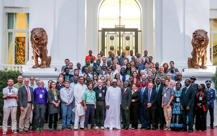 In front of the Presidential Palace with Macky Sall, President of the Republic of Senegal. The group photo includes Senegal, French, and US researchers, and French and US diplomatic representation.