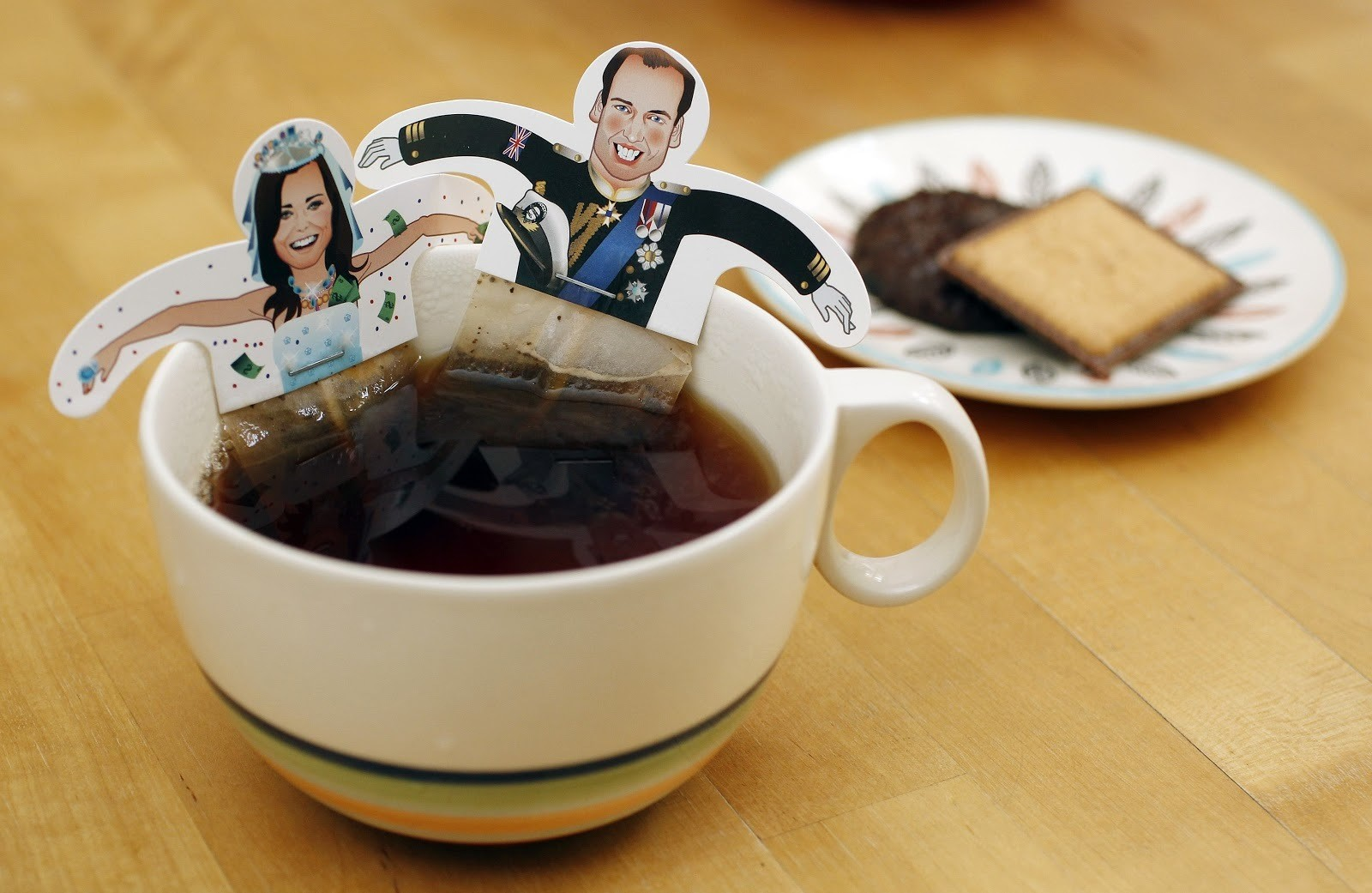 Souvenir teabags with depictions of Britain's Prince William and Kate Middleton are seen in London April 7, 2011. A British minister said on Wednesday that two billion people were expected to tune in to TV broadcasts to watch this month's royal wedding between Prince William and Kate Middleton on April 29.   REUTERS/Suzanne Plunkett (BRITAIN - Tags: ROYALS ENTERTAINMENT SOCIETY) - LM1E74718CS01