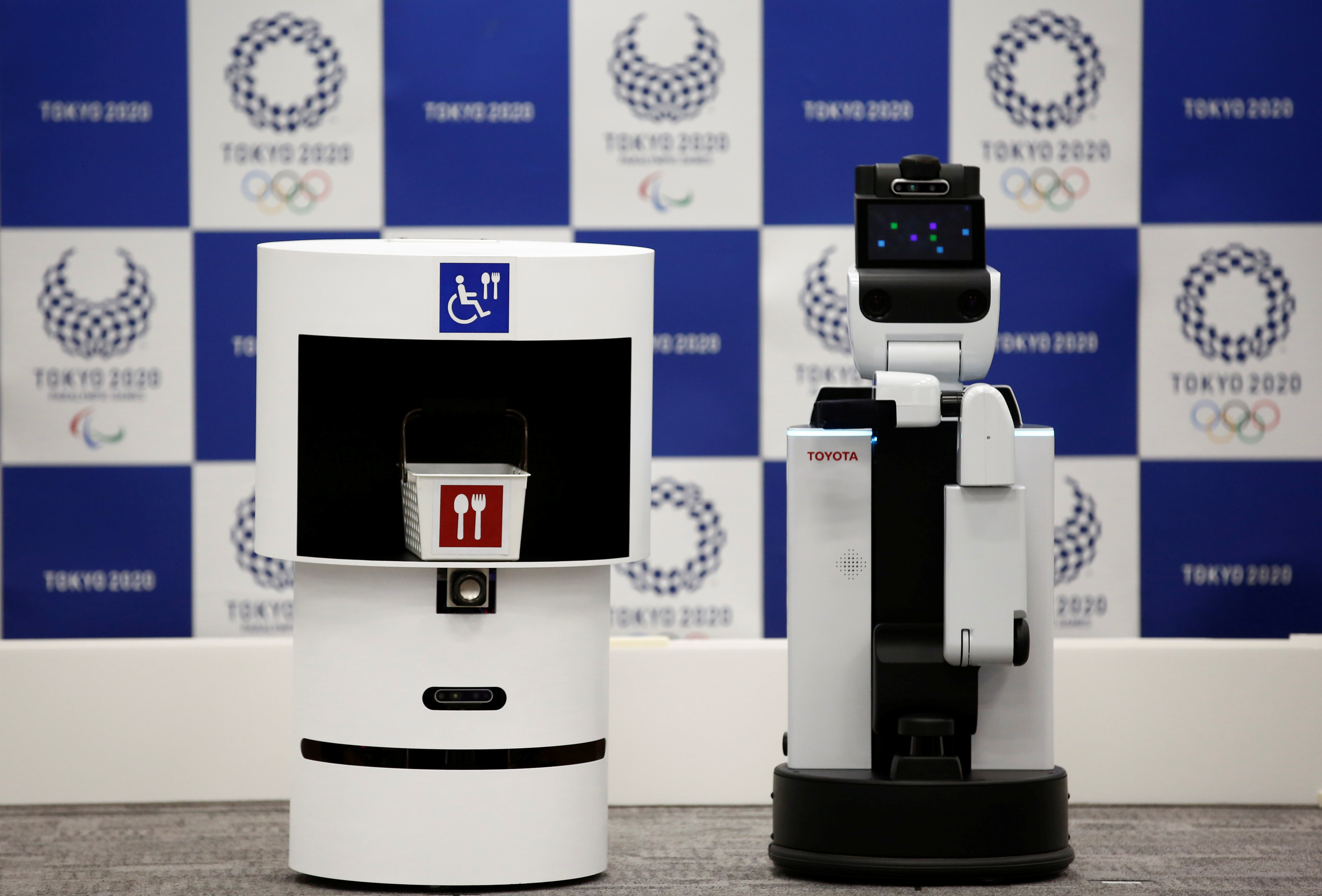 Toyota's DSR (Delivery Support Robot) (L) and HSR (Human Support Robot) are pictured at a demonstration of Tokyo 2020 Robot Project for Tokyo 2020 Olympic Games in Tokyo, Japan, March 15, 2019. REUTERS/Kim Kyung-hoon - RC1E57760890