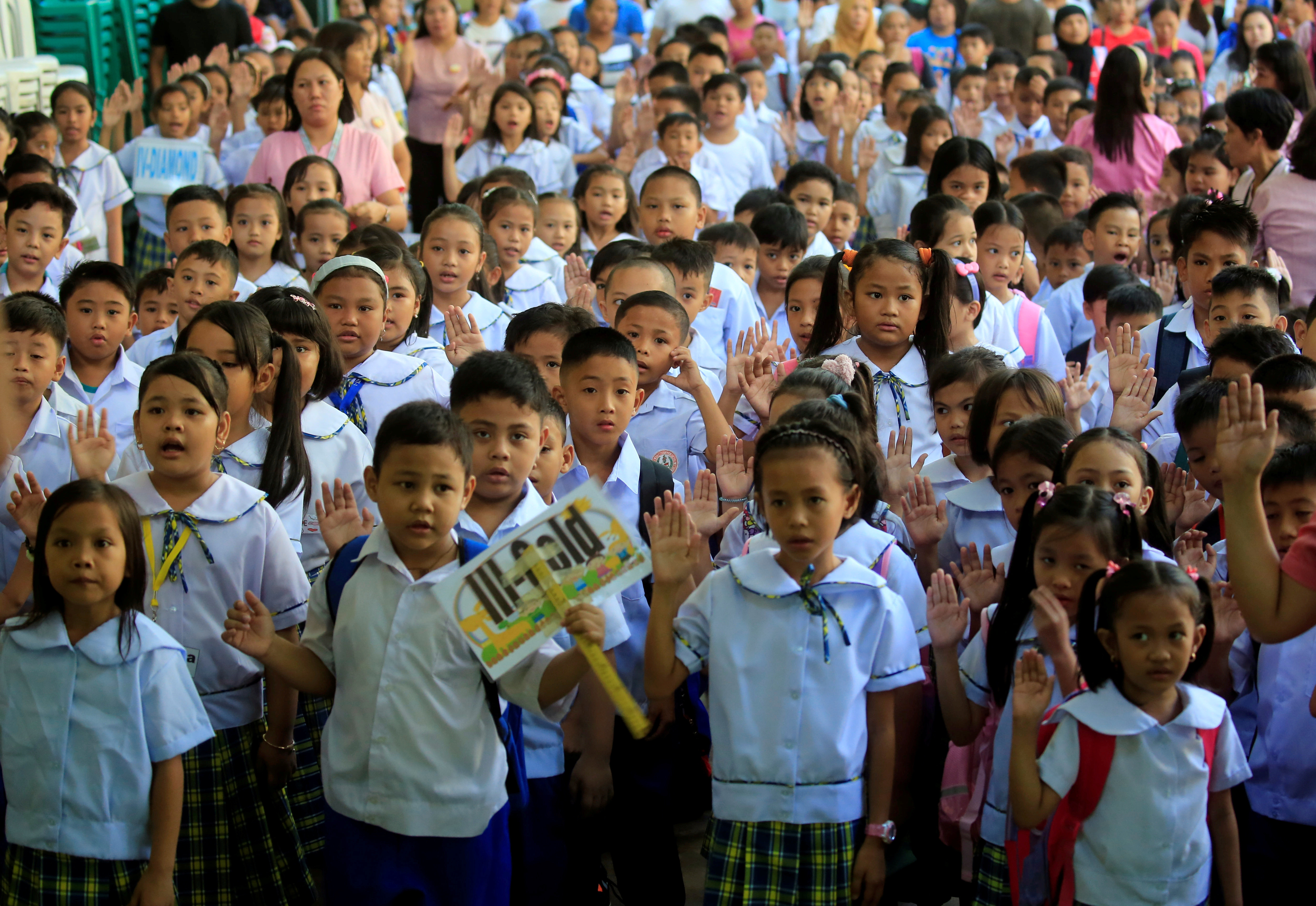 Filipino children recite an oath of allegiance to the country on the first day of the school year in Parañaque, Manila.