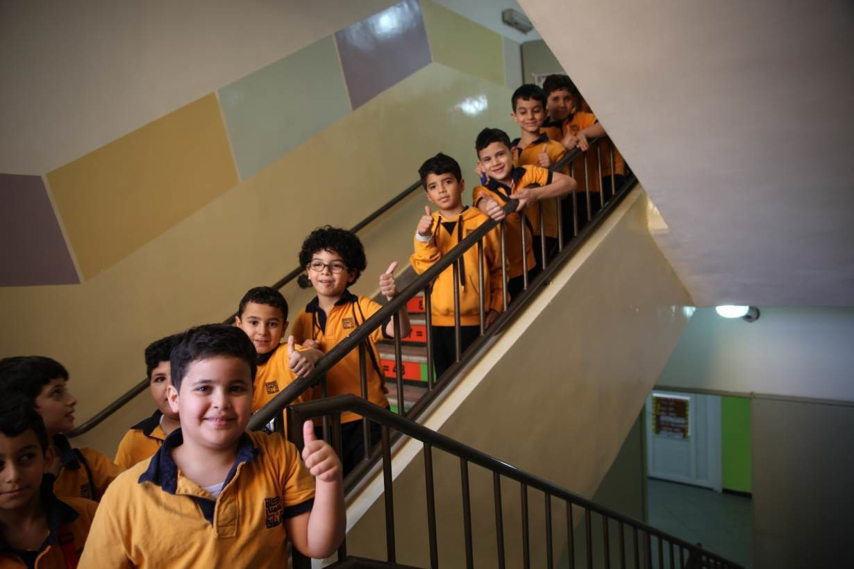 Students at the Al Hoffaz academy pose on school stairs in Amman, Jordan, September 25, 2018.