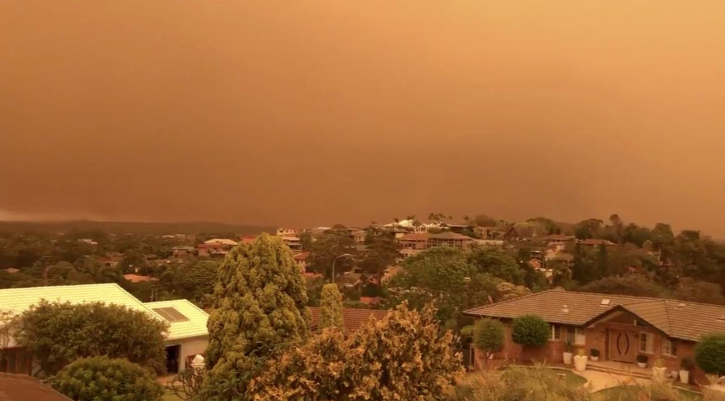 Smoke with orange tint blanketing skies and orange hues are seen from a kitchen window in Port Macquarie, Australia, November 8, 2019.