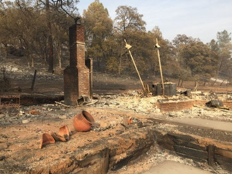 The remains of a house recently burned in northern California. Centre left are two fire-blackened pots. The owners escaped unscathed