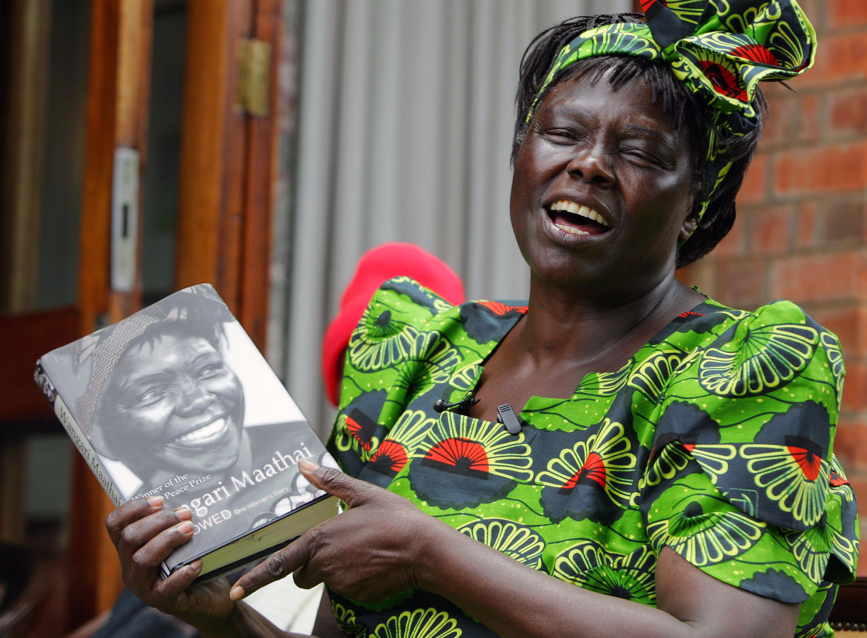 Kenyan Assistant Minister for Environment and Nobel Peace Laureate Wangari Maathai holds her book