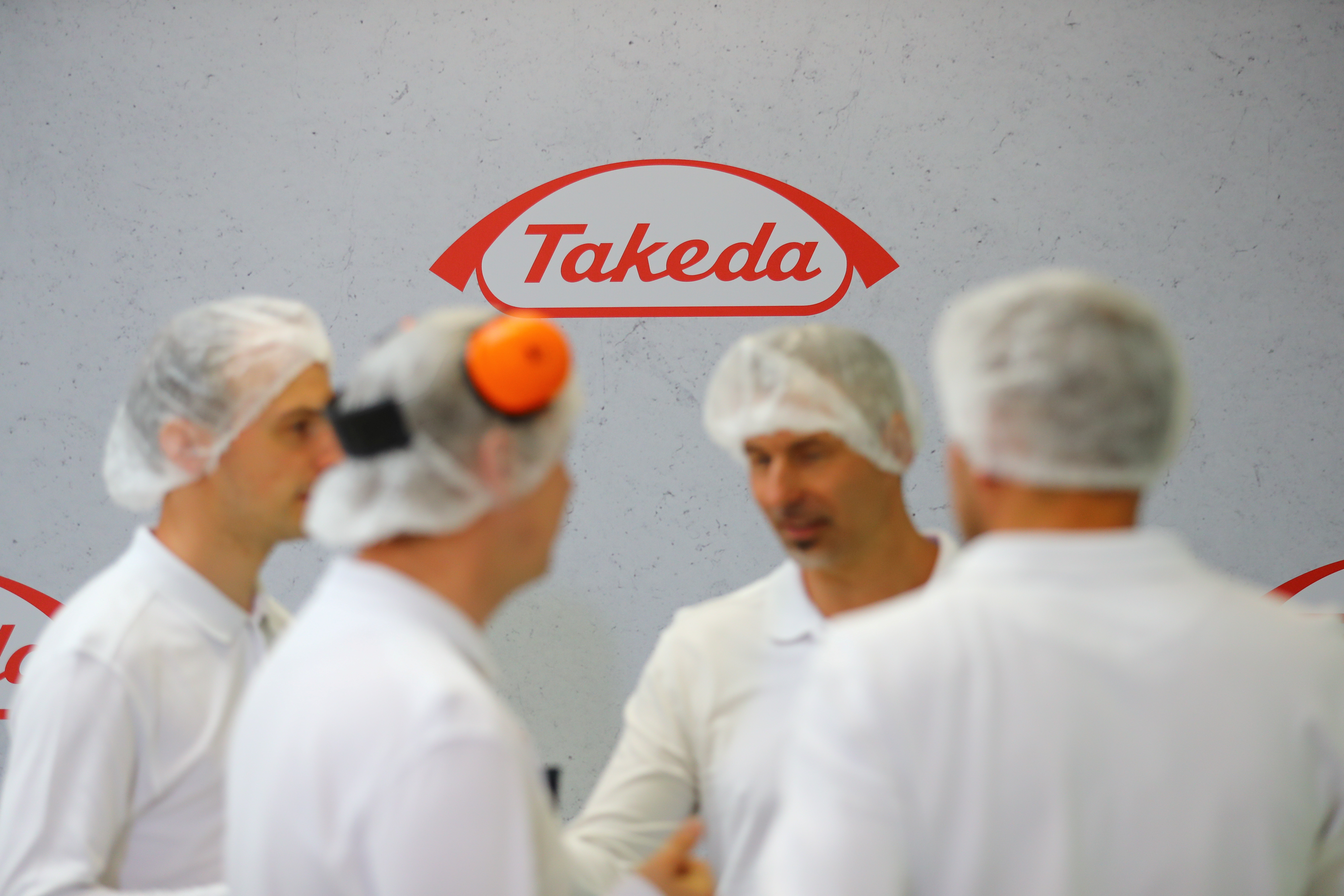 Workers at a Takeda pharma factory