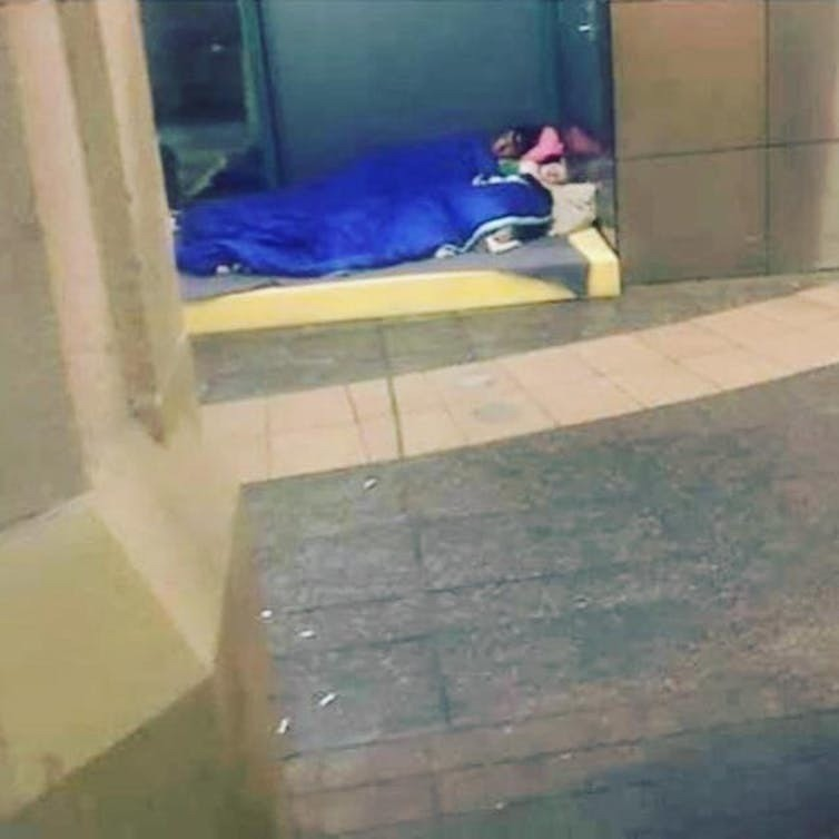 This image of a mother and her baby sleeping out in the cold in Sydney was widely shared on social media (they received help as a result).
