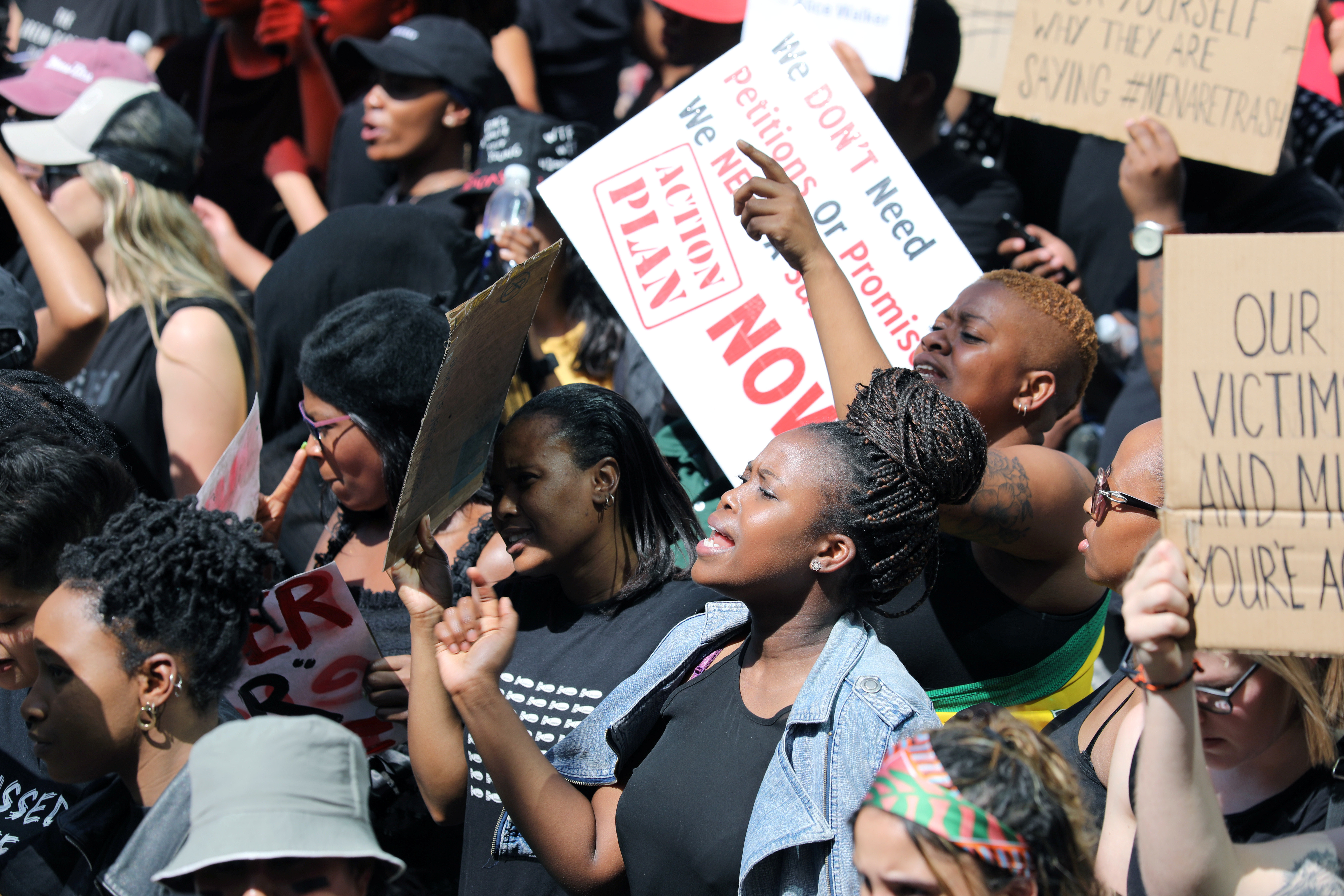 Women hold placards as they  protest against gender-based violence, outside the Johannesburg Stock Exchange in Sandton, Johannesburg, South Africa, September 13, 2019. REUTERS/Marius Bosch - RC1B04A96A60