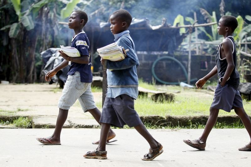 Children return from school in the mid-morning, in Ikarama village on the outskirts of the Bayelsa state capital, Yenagoa, in Nigeria's delta region October 8, 2015. Tensions are building in the swampland of the Niger Delta as an amnesty that aimed to bring stability to Nigeria's volatile southern region is due to expire at the end of the year. While the region's towns and cities are mostly calm, local residents say kidnappings and armed robberies are on the increase in the mangrove swamps, where most oil wells are located. Former military ruler and Muslim northerner President Muhammadu Buhari said in his inauguration speech in May that he might