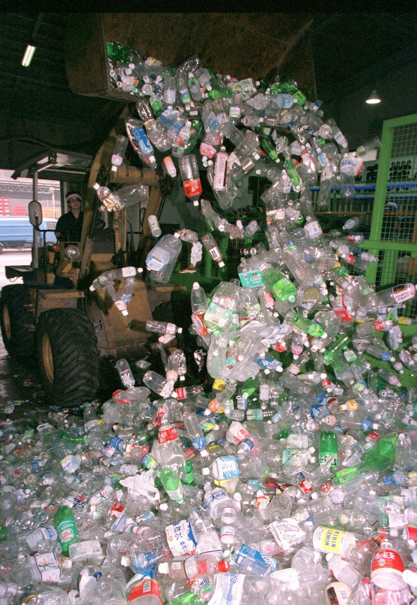 A bulldozer scrapes up piles of empty plastic bottles at a recycling plant in Tokyo August 19. Worries about the safety of tap water are boosting sales of bottled water and tea in Japan, leaving piles of empty plastic bottles behind in a country that is already running out of garbage dumps. Industry officials estimate consumption of small-sized PET (polyethylene terephthalate) bottles will reach 3.5 billion to four billion units this year, nearly the double the 2.2 billion used last year and compared with a more 640 million in 1996. Picture taken 19AUG98.ST/CC - RTRGJ8A