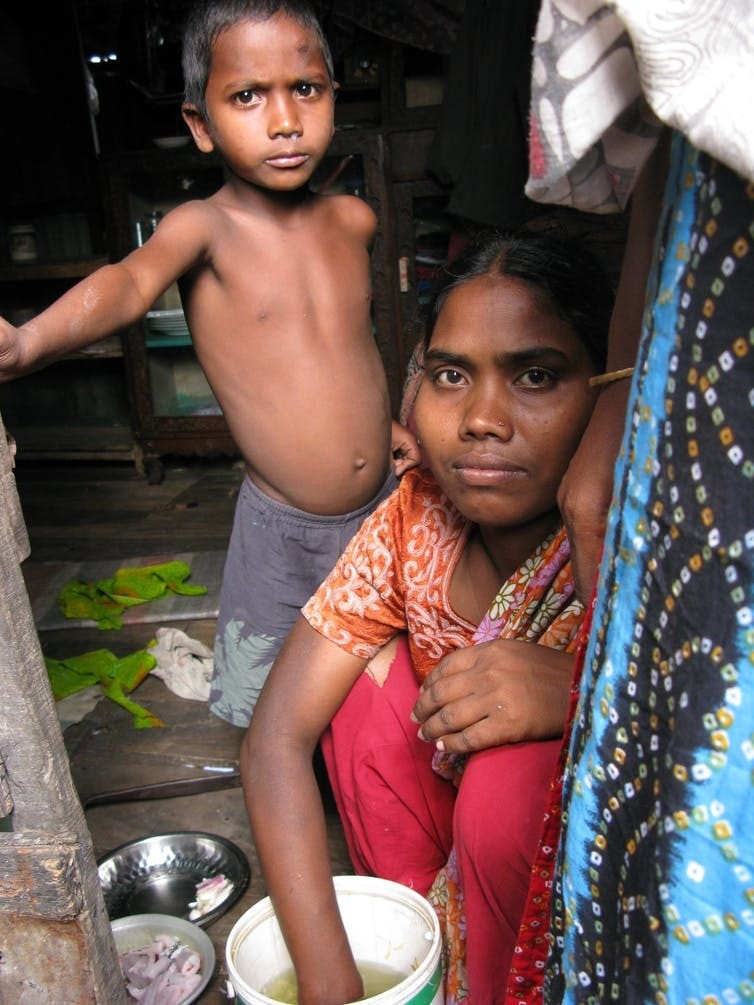 Mother and child in a Dhaka slum.