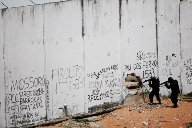 Riot policemen carry their weapons during an uprising at Alcacuz prison in Natal, Rio Grande do Norte state, Brazil.