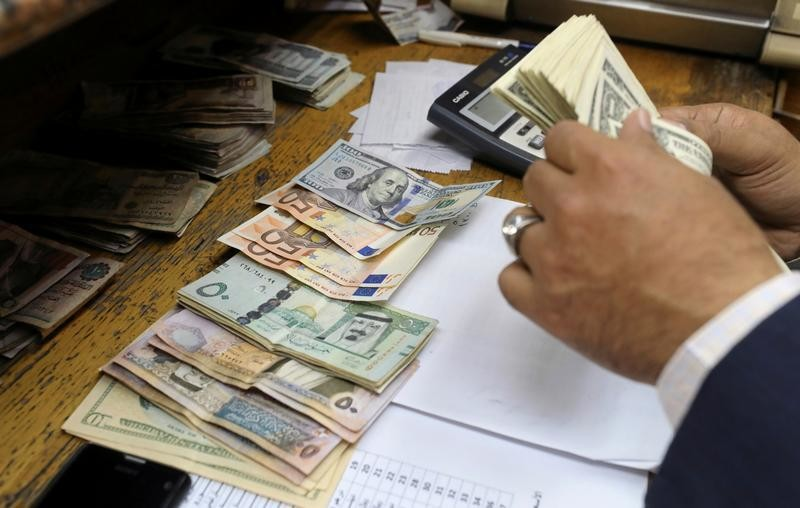A man counts U.S dollar and Euro banknotes at a money exchange office in central Cairo, Egypt, March 7, 2017.
