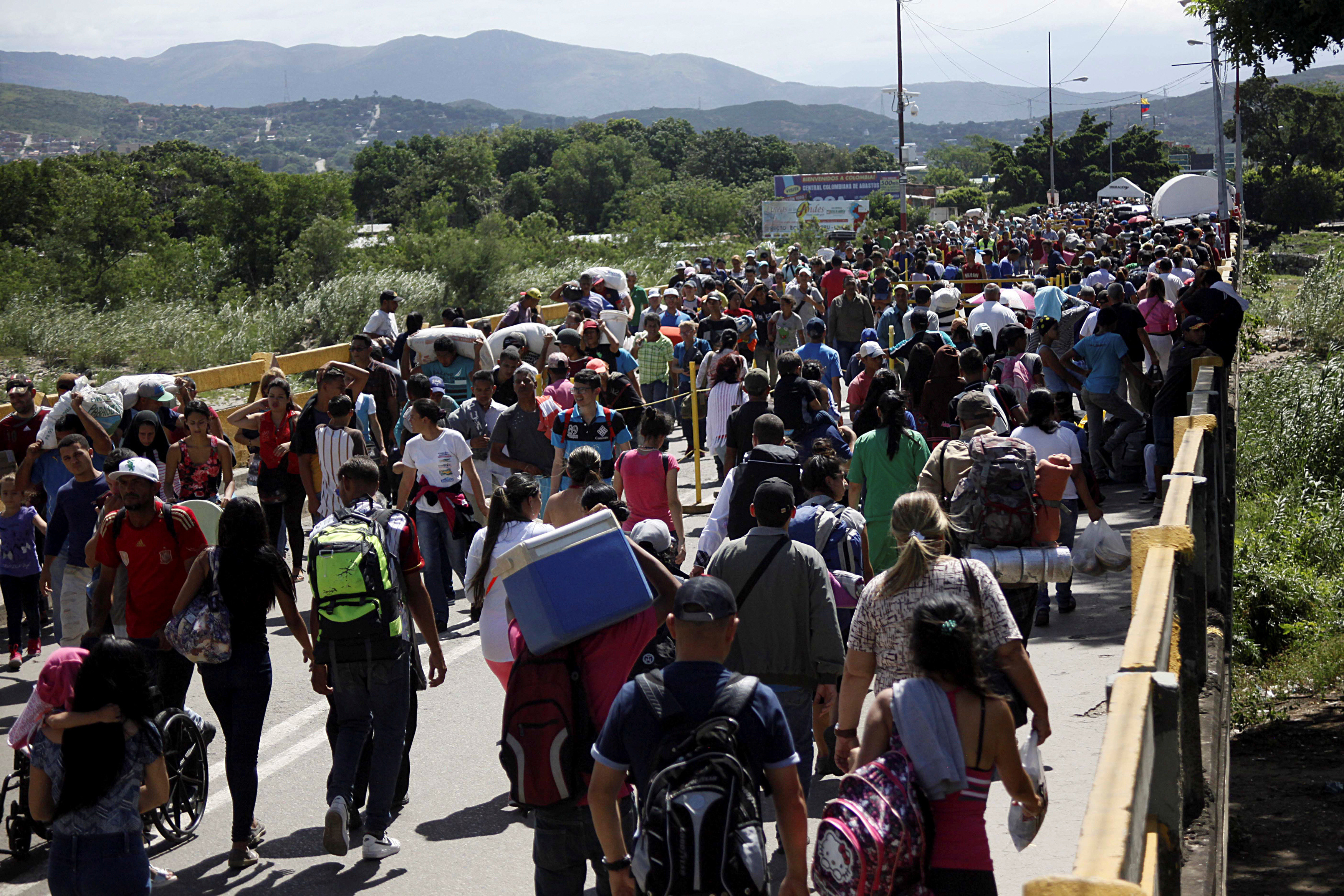 Venezuelans cross the border into Colombia in May this year.