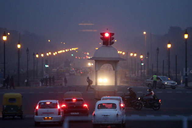 Traffic stands at a junction on King's Way boulevard while shrouded in smog at night in New Delhi, India, on Monday, Dec. 4, 2017. The World Health Organizationwarnsthat increasing airpollutionin many of the world's poorest cities is driving up the risk of stroke, heart disease and lung cancer in vulnerable populations. TheWorld Bankestimated that 1.4 million people in India died prematurely due to airpollutionin 2013, the latest year for which data is available. Photographer: Anindito Mukherjee/Bloomberg via Getty Images
