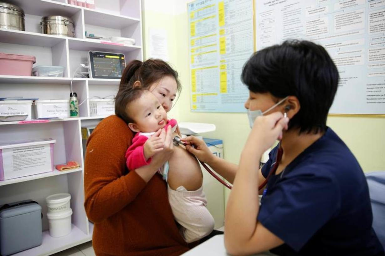 Ulzii-Orshikh Otgon, 34, visits a doctor for her 10-month-old daughter Achmaa, diagnosed with pneumonia, at a children's hospital in Bayangol district of Ulaanbaatar, Mongolia, January 31, 2019.