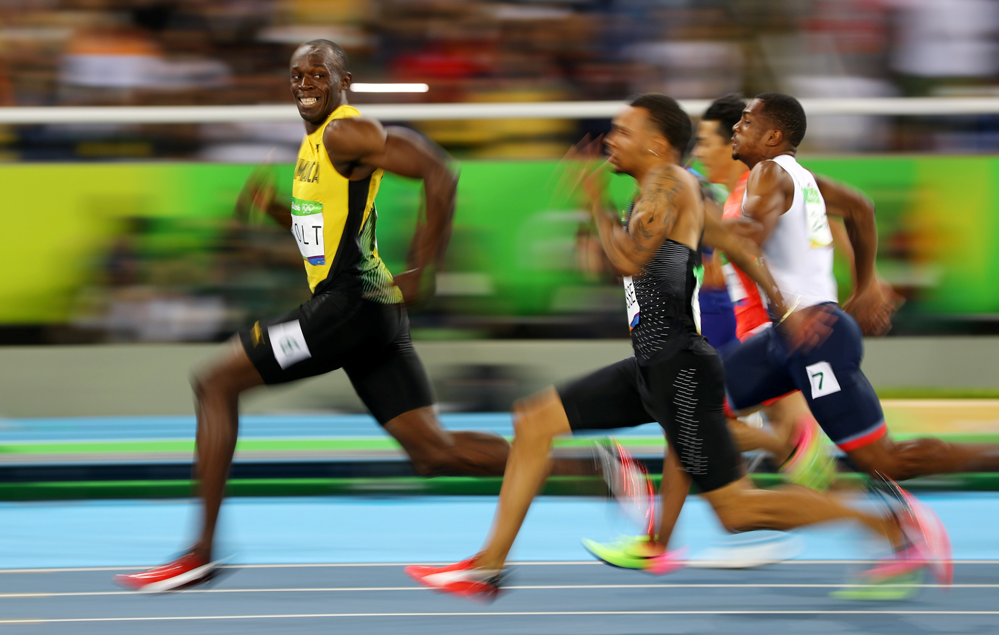 Usain Bolt (JAM) of Jamaica looks at Andre De Grasse (CAN) of Canada as they compete in the 2016 Rio Olympics, Men's 100m Semifinals at the Olympic Stadium in Rio de Janeiro, Brazil, August 14, 2016.  Picture taken August 14, 2016