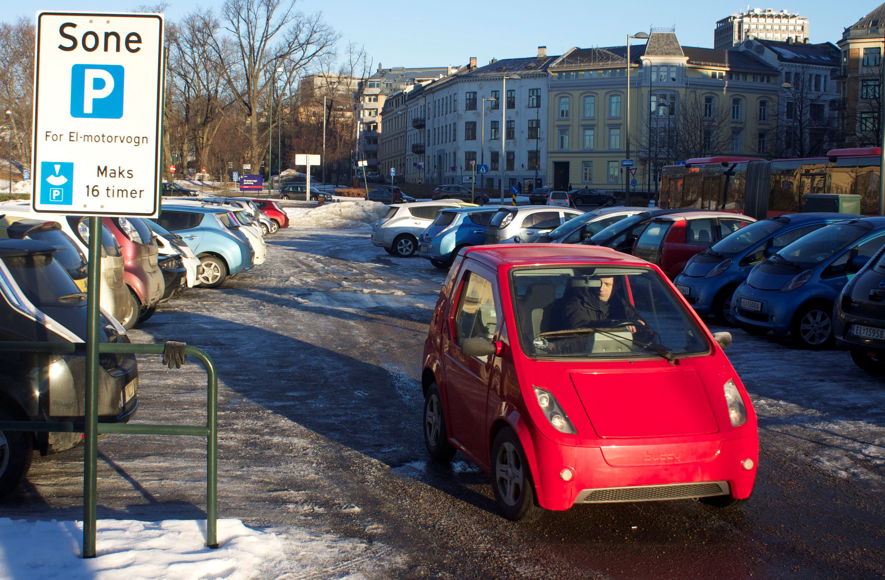 A driver leaves a free car park reserved for electric vehicles in Oslo, Norway, February 25, 2013.