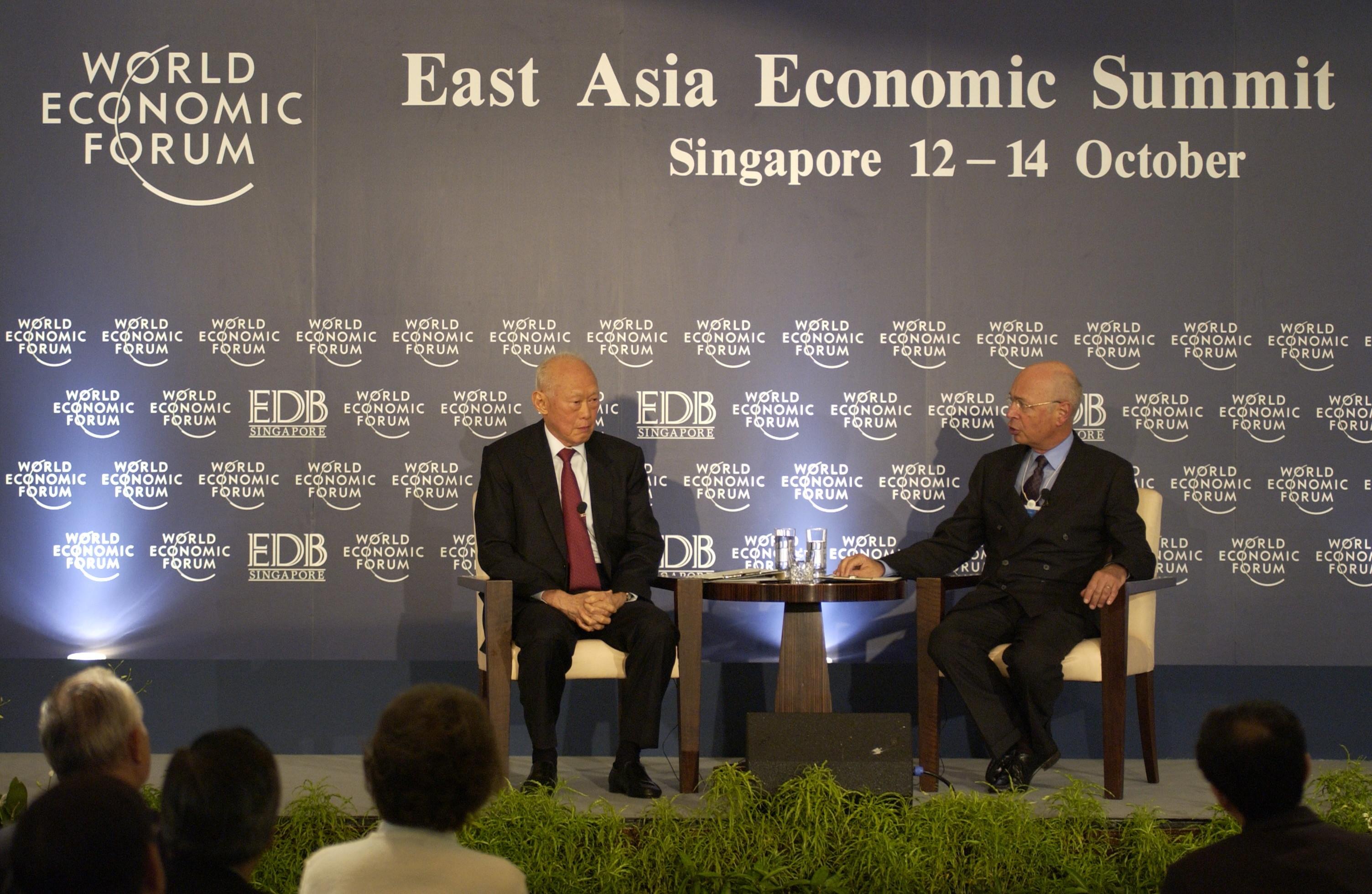 Lee Kuan Yew, Senior Minister, Singapore, having a conversation with Klaus Schwab, Executive Chairman of the World Economic Forum.
