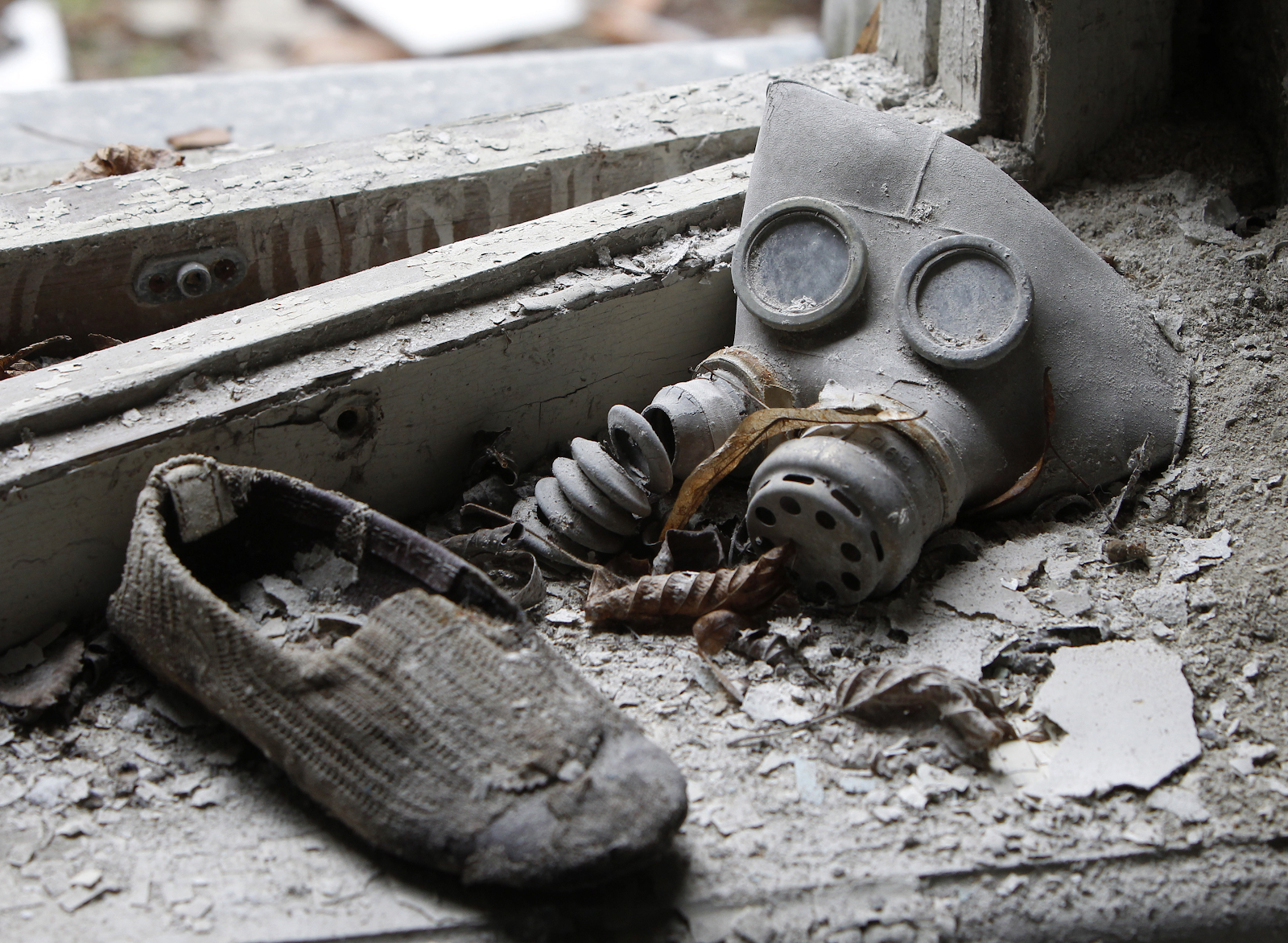 A child's gas mask and a shoe at a kindergarten in the abandoned city of Pripyat.