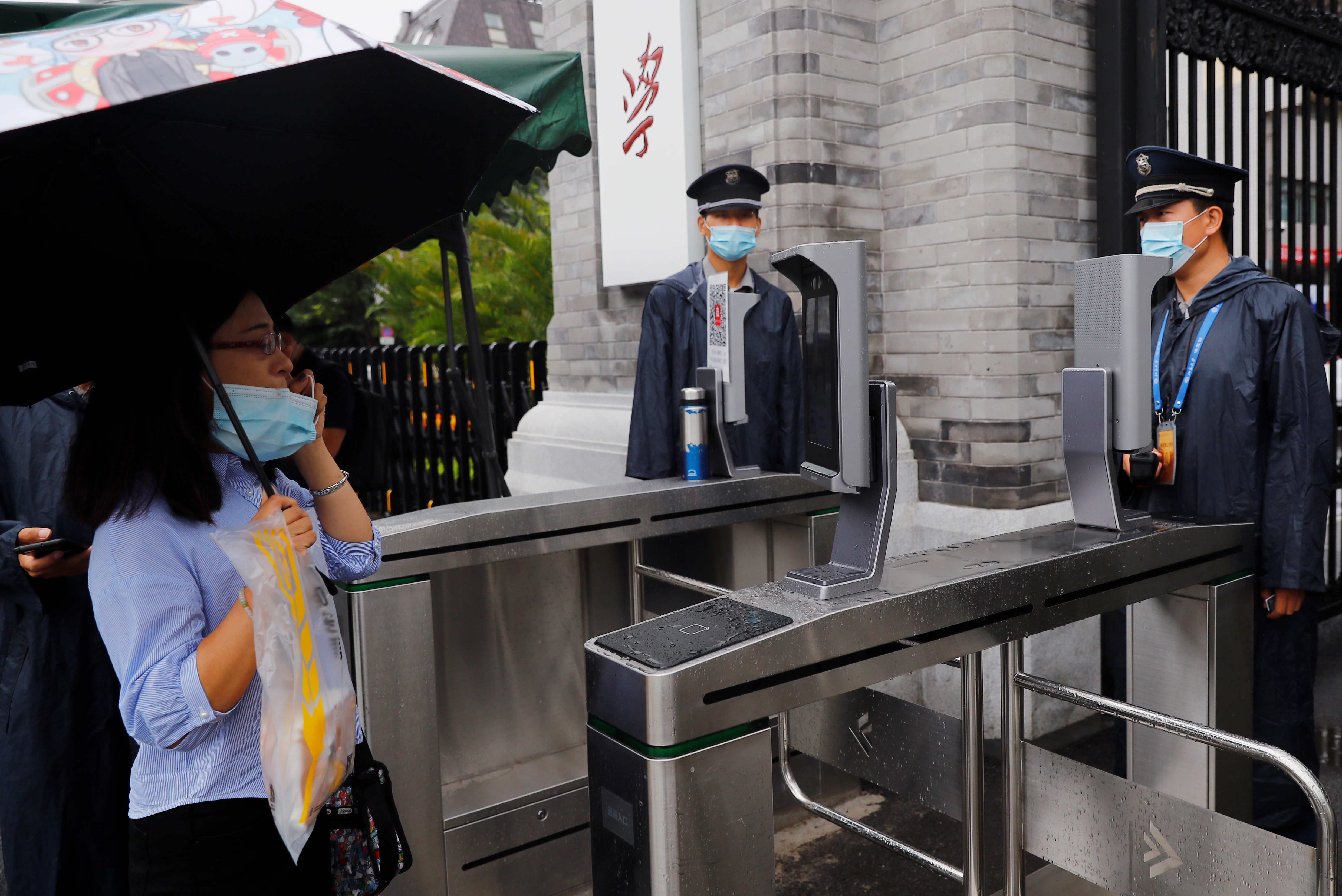 Students pass through a gate using facial recognition technology as they enter Peking University in Beijing, China, 31 August 2020.