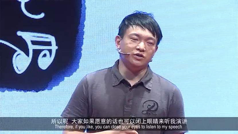 A screenshot of Zhang Ping giving a speech in Shanghai, June 2014.