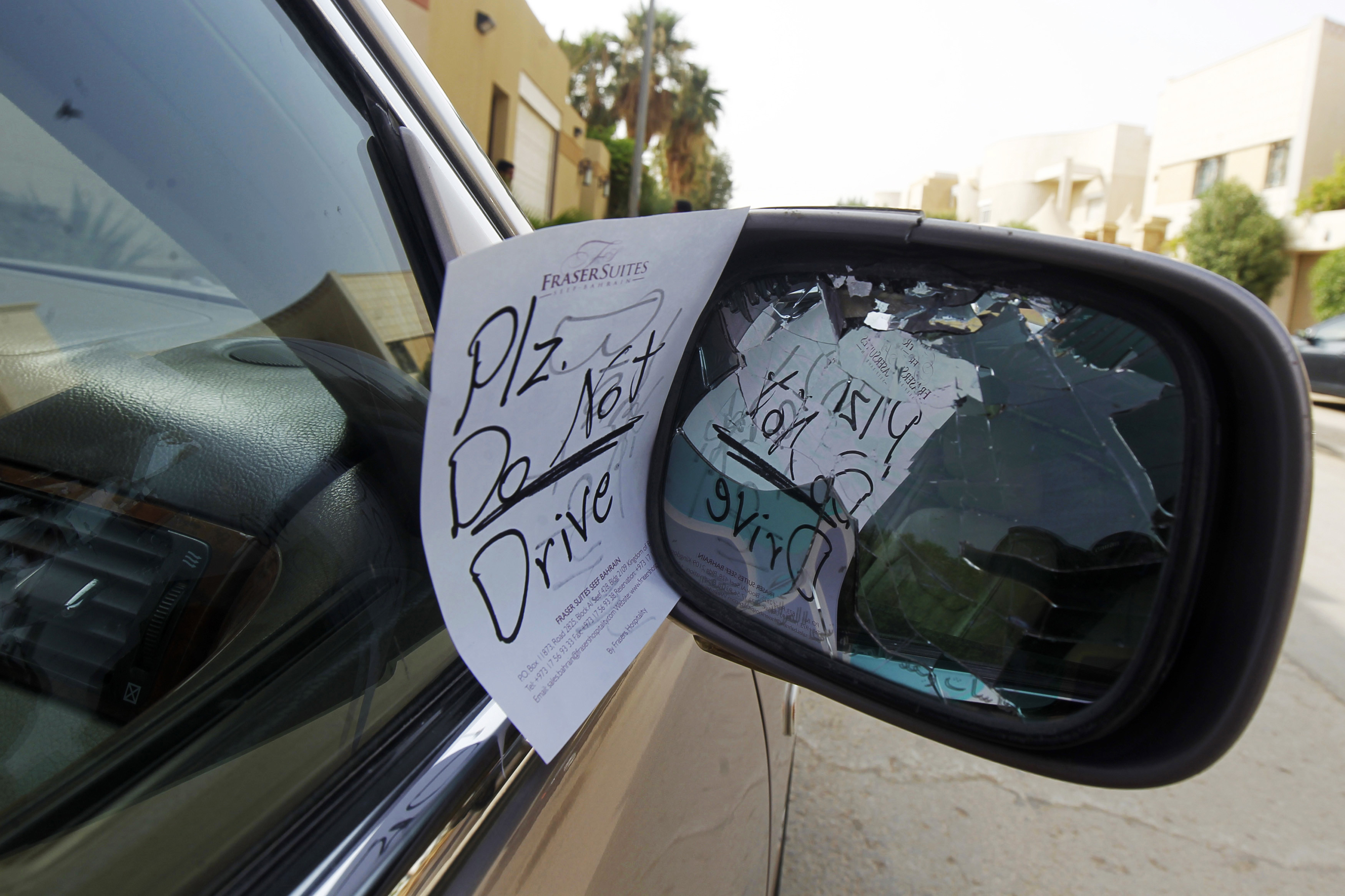 A note placed by an unknown person on female driver Azza Al Shmasani's car, is pictured in Saudi Arabia June 22, 2011. Saudi Arabia has no formal ban on women driving. But as citizens must use only Saudi-issued licences in the country, and as these are issued only to men, women drivers are anathema. An outcry at the segregation, which contributes to the general cloistering of Saudi women, has been fuelled by social media interest in two would-be female motorists arrested in May.  REUTERS/Fahad Shadeed   (SAUDI ARABIA - Tags: TRANSPORT SOCIETY) - RTR2NYLS