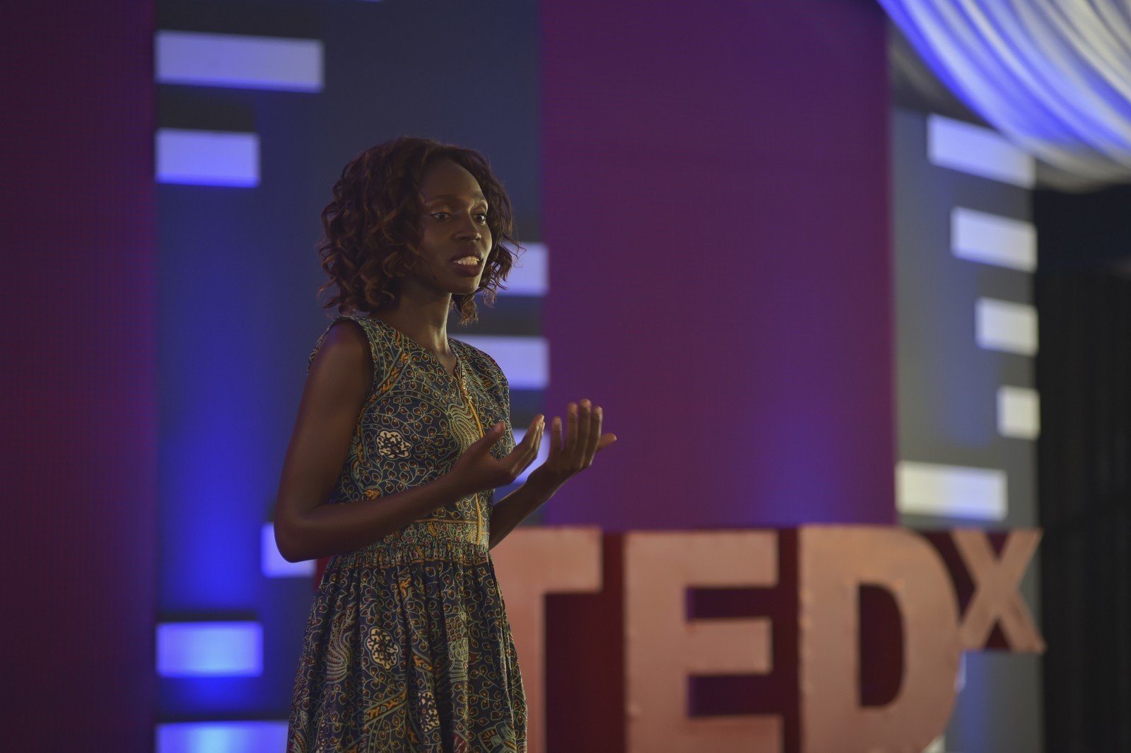 Mercy Akuot, who supervises a women and girls empowerment program in Kakuma refugee camp, speaks on stage at at the first ever TEDx event held at a refugee camp