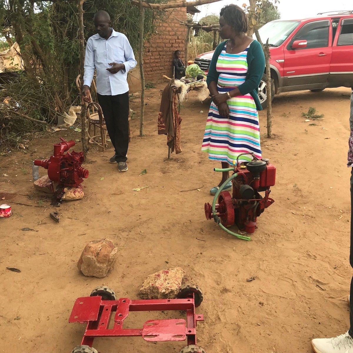 Abel Mutie with a biodiesel irrigation pump and generator pump.
