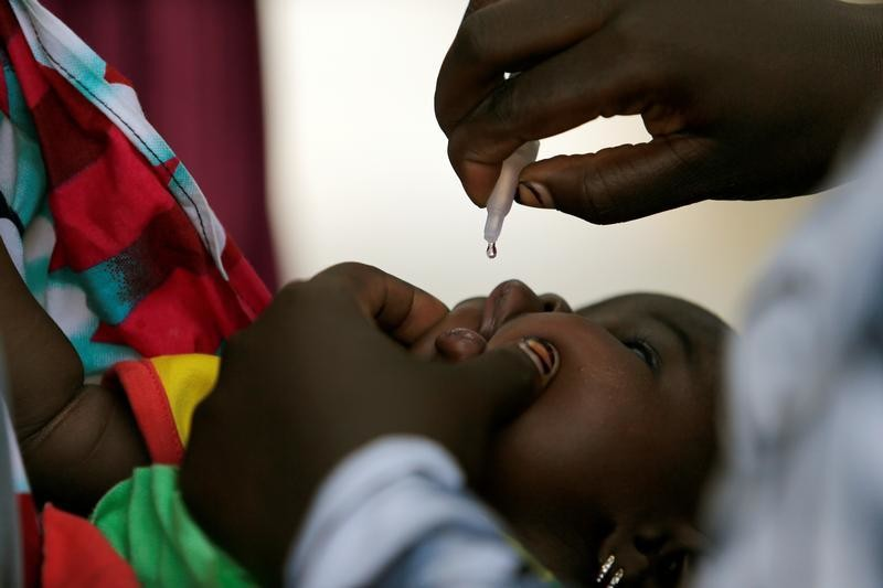 A child is given a dose of polio vaccine at an immunisation health centre, in Maiduguri, Borno State, Nigeria, August 29, 2016. REUTERS/Afolabi Sotunde      SEARCH