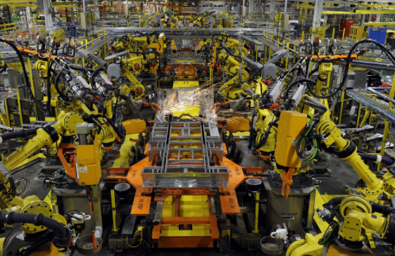 Robotic arms weld the chassis of a Ford Transit Van under assembly at the Ford Claycomo Assembly Plant in Claycomo, Missouri