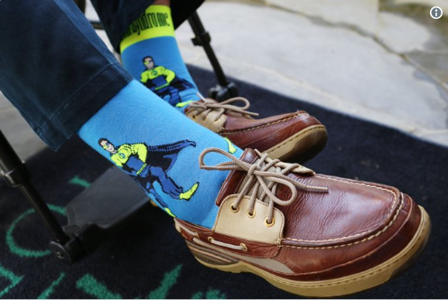 George W. Bush wearing John's superhero socks to mark World Down Syndrome Day