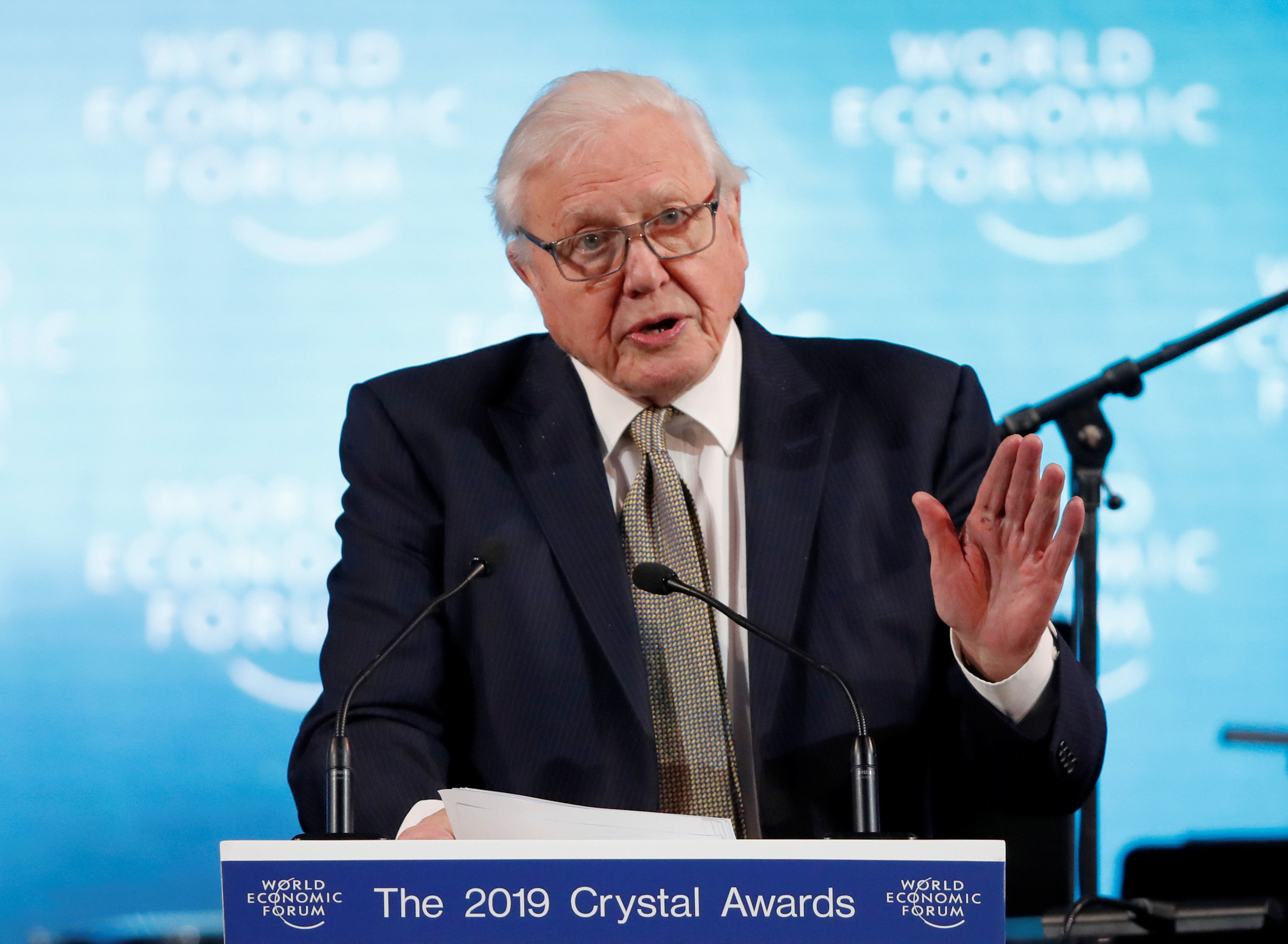 Naturalist Sir David Attenborough delivers a speech as he receives a Crystal Award, during an opening ceremony of the World Economic Forum (WEF) in Davos, Switzerland, January 21, 2019. REUTERS/Arnd Wiegmann