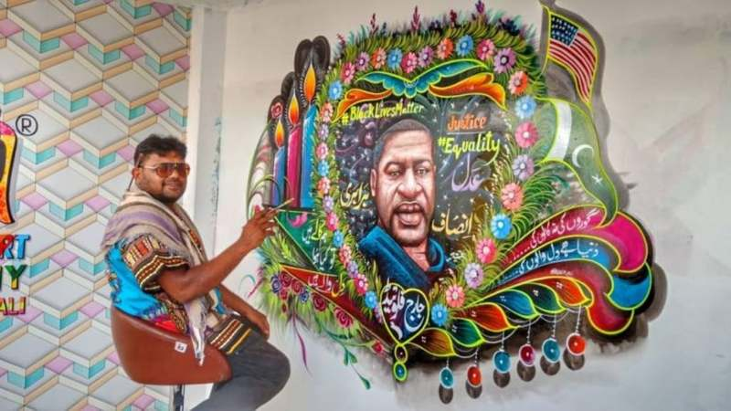 "Mural tribute to George Floyd painted by truck artist Haider Ali in Karachi, Pakistan, reading: ""This world does not belong to white or black people, it belongs to the ones with a heart."""