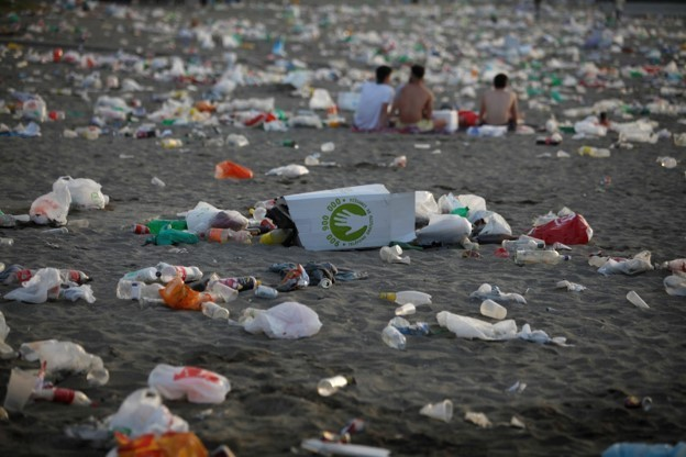 Rubbish strewn on a beach in Malaga, Spain, after the Summer Solstice.