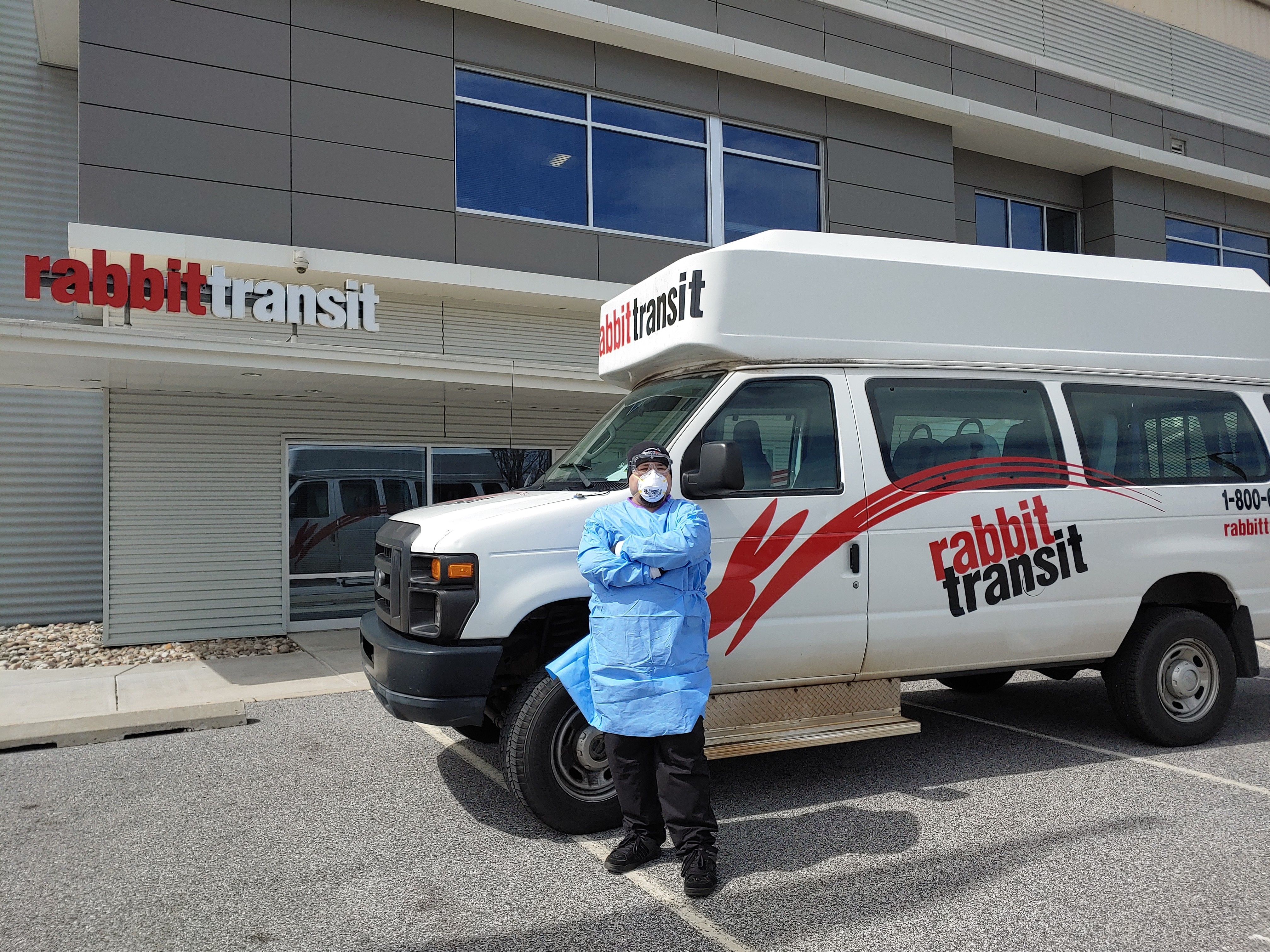 """While supplies last, rabbittransit operator Josh Medina outfits with mask and hospital gown to protect himself and his clientele. """"We are running very low [on supplies],"""" says CEO Richard Farr. """"We have ordered a ton but the delivery dates keep getting pushed back."""""""