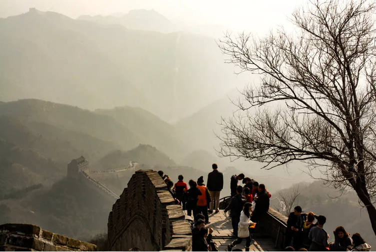Tourists are seen on the Great Wall of China.
