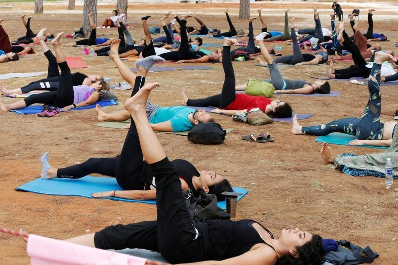 People practice yoga during a yoga festival at Beirut Hippodrome, Lebanon, September 16, 2017. Picture taken September 16, 2017. REUTERS/ Mohamed Azakir - RC19654CCA00