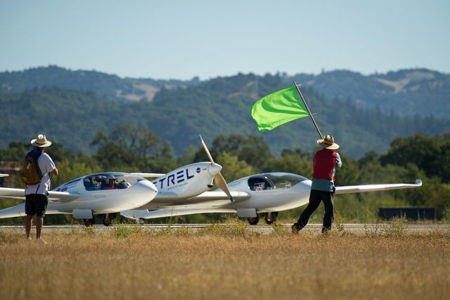 A fuel-efficient airplane takes off during NASA's Green Flight competition